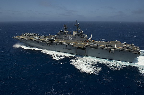 The amphibious assault ship USS America performs flight o...