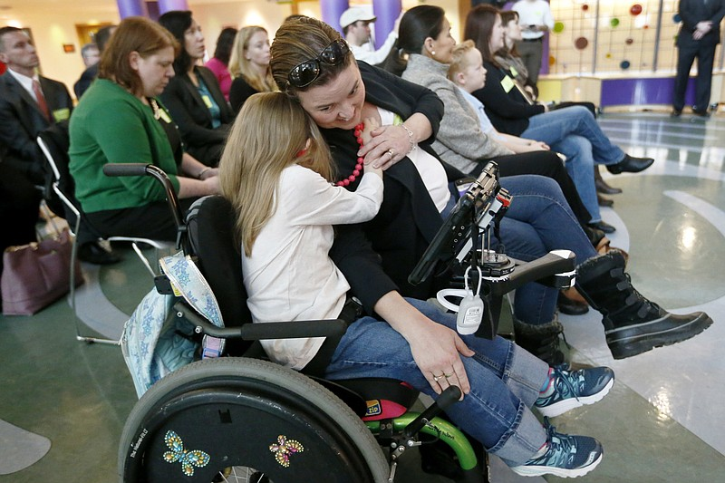 Eight-year-old Abigail Gabriel hugs her mother as Pennsylvania Department of ...