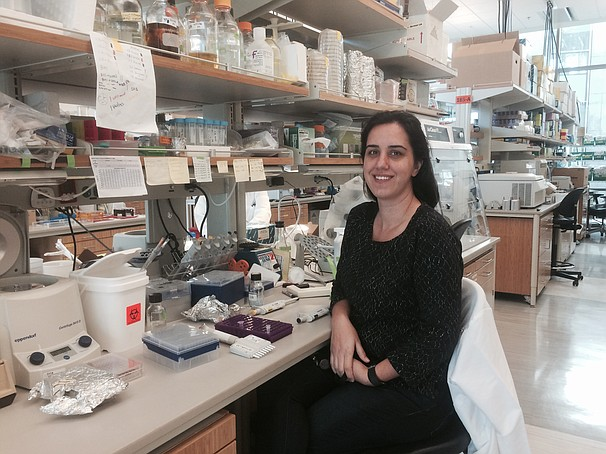 Sinem sits in her lab at the J. Craig Ventner institute in La Jolla