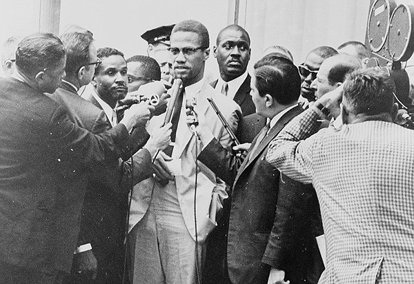Malcolm X with reporters in