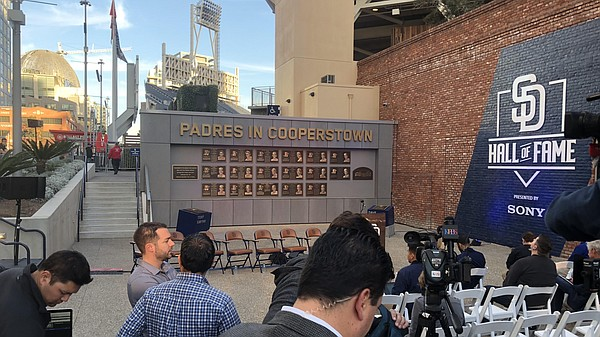 Camera crews wait for the Padres to make an announcement ...