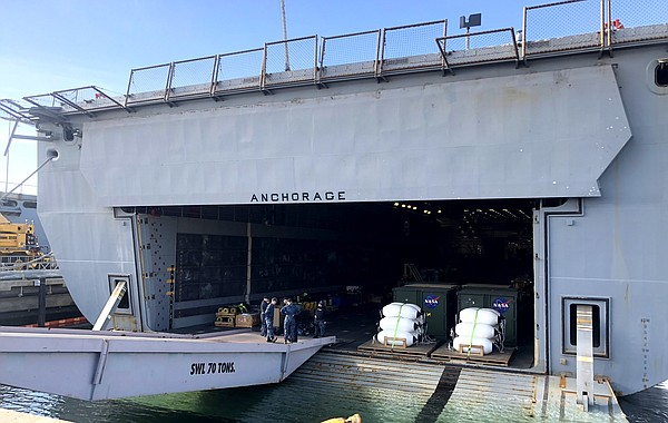 The test capsule is loaded onto USS Anchorage's (LPD 23) ...