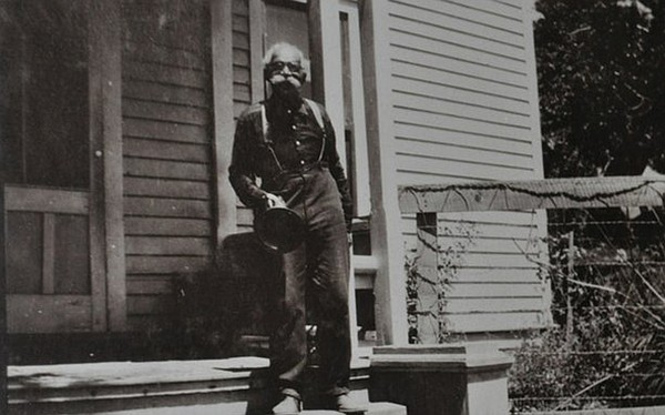 Black pioneer, Albert Robinson, in front of the Hotel Rob...