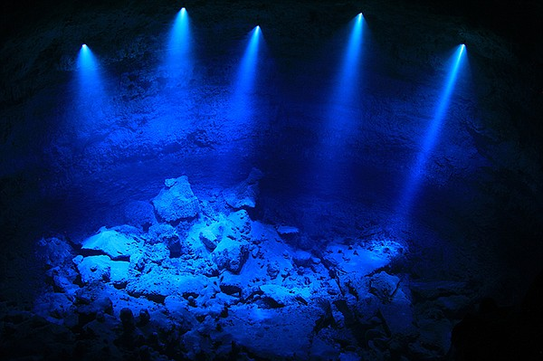 The underwater lighting reveals the depth of the cave, Ho...