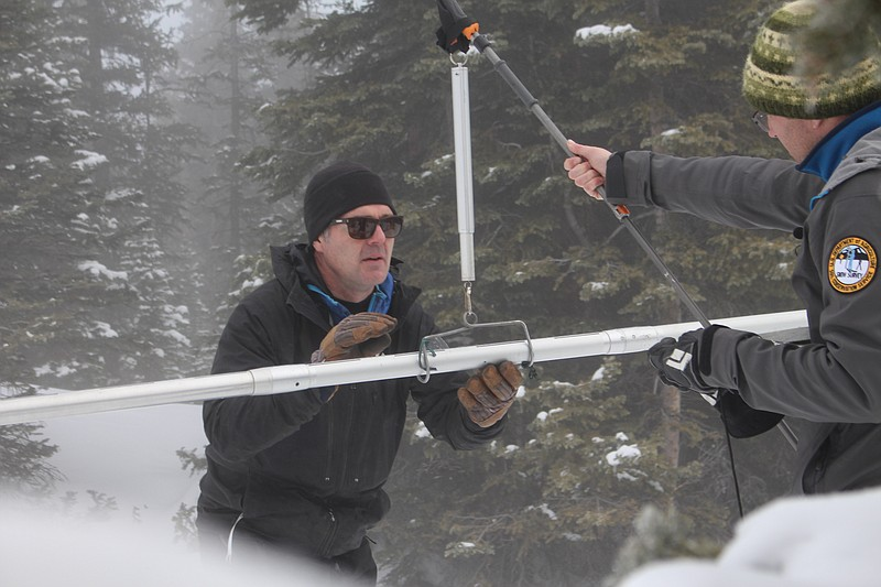 Natural Resources Conservation Service snow surveyors Mike Ardison (left) and...