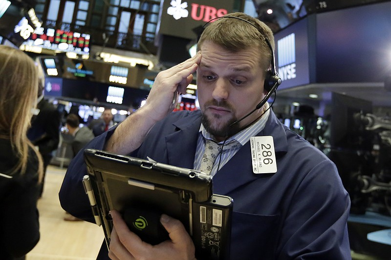 Trader Michael Milano works on the floor of the New York Stock Exchange, Tues...