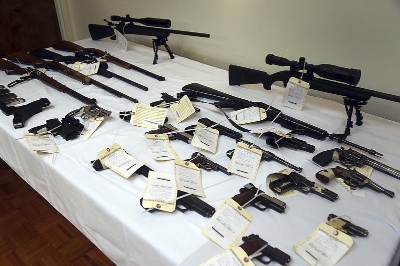A cache of seized weapons is displayed during a press conference in Los Angel...