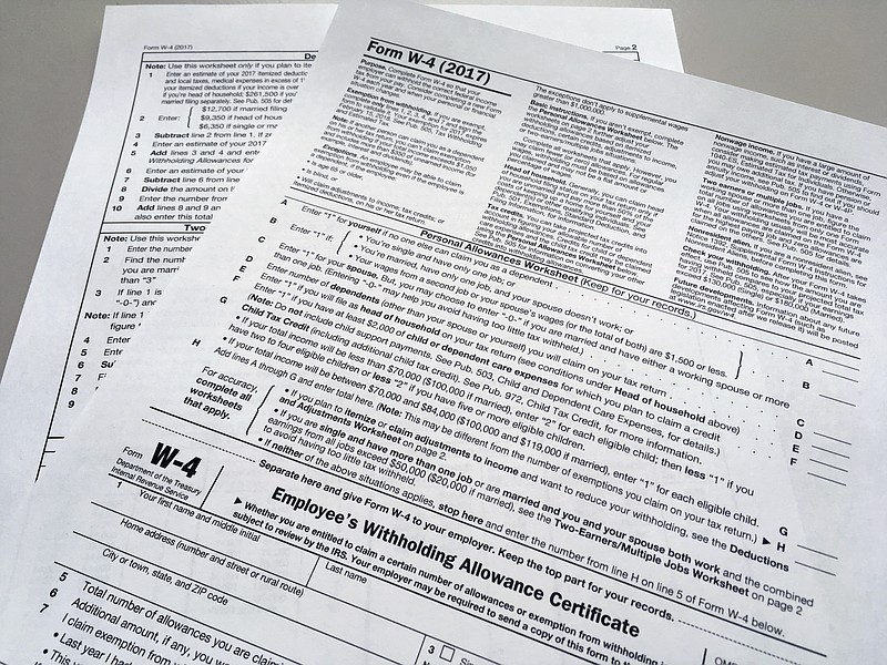 This photo shows an IRS W-4 form on Feb. 1, 2018, in New York.