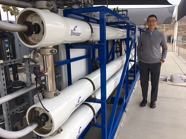 Water engineer Al Lau stands next to the reverse osmosis ...