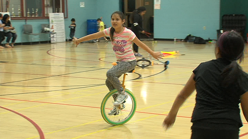 Ten-year-old Naomi Corona rides a unicycle in the Fern Street Circus after-sc...