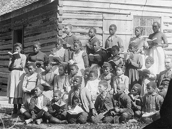 Group of freed slaves with books.