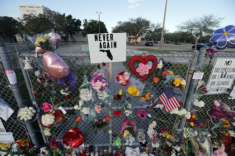 A makeshift memorial is seen outside the Marjory Stoneman Douglas High School...