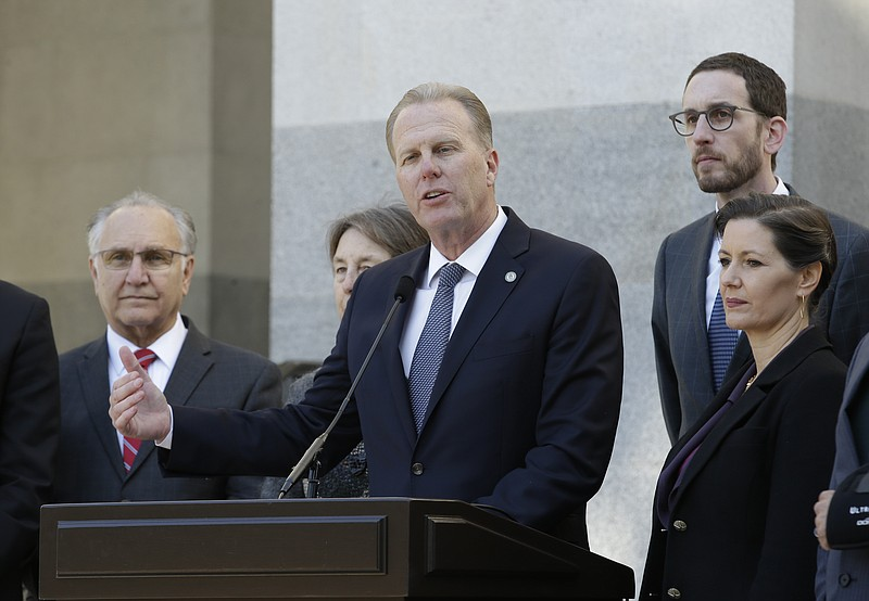 San Diego Mayor Kevin Faulconer, center, discusses California's growing homel...