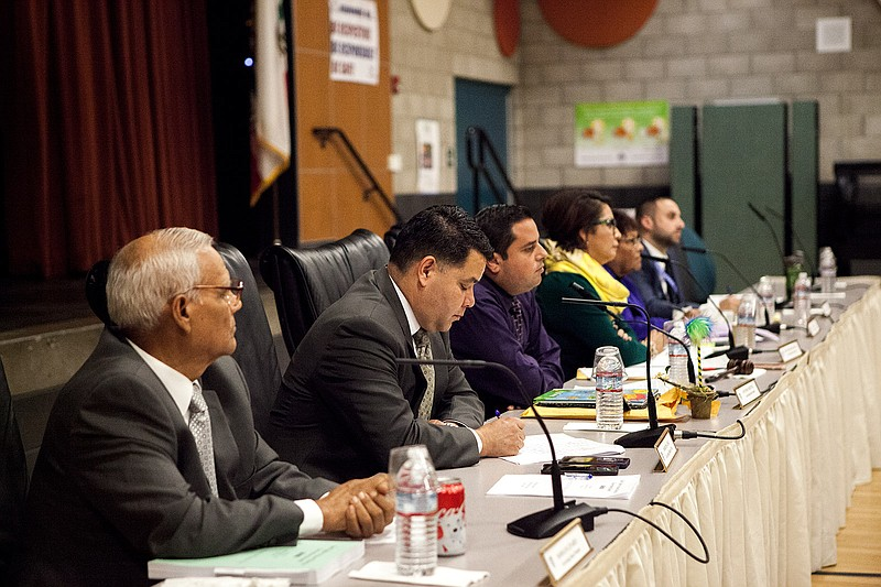 San Ysidro School District board members listen to speakers during a Nov. 9, ...