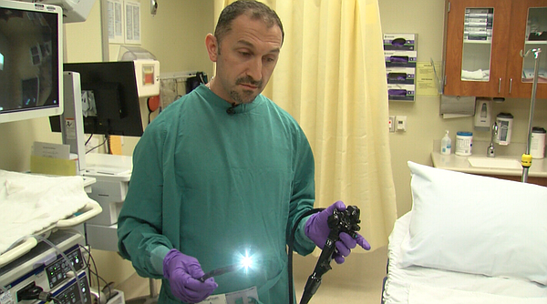Dr. Michael Lajin demonstrates the endoscopic procedure f...