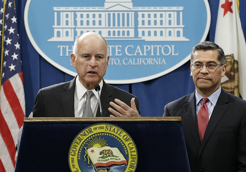 California Gov. Jerry Brown, left, accompanied by California Attorney General...