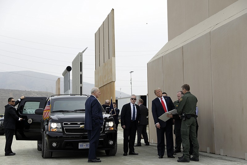 President Donald Trump reviews border wall prototypes in San Diego, Ca., Tues...