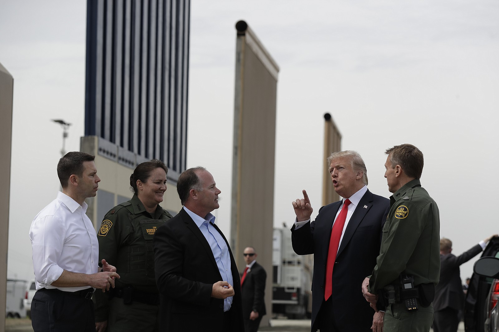 President Donald Trump reviews border wall prototypes in San Diego, Tuesday, ...