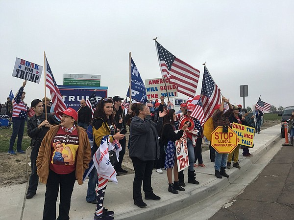 Supporters of President Donald Trump rally near the U.S.-...
