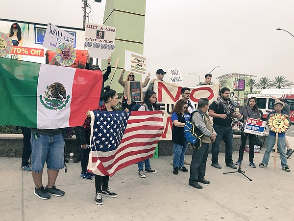 Protesters gather at the San Ysidro Port of Entry to spea...