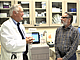 Dr. Daniel Anderson visits with colorectal cancer survivor Walter Roussell, M...