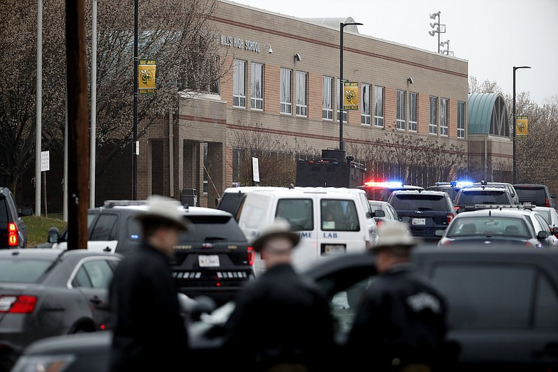 Deputies and federal agents converge on Great Mills High School, the scene of...