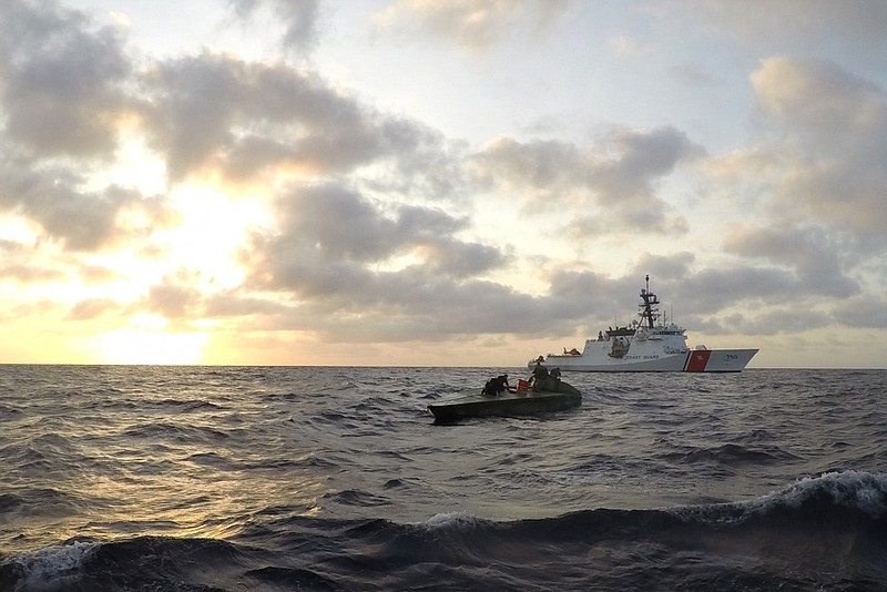 Boarding team members from the Coast Guard Cutter Bertholf and Pacific Tactic...
