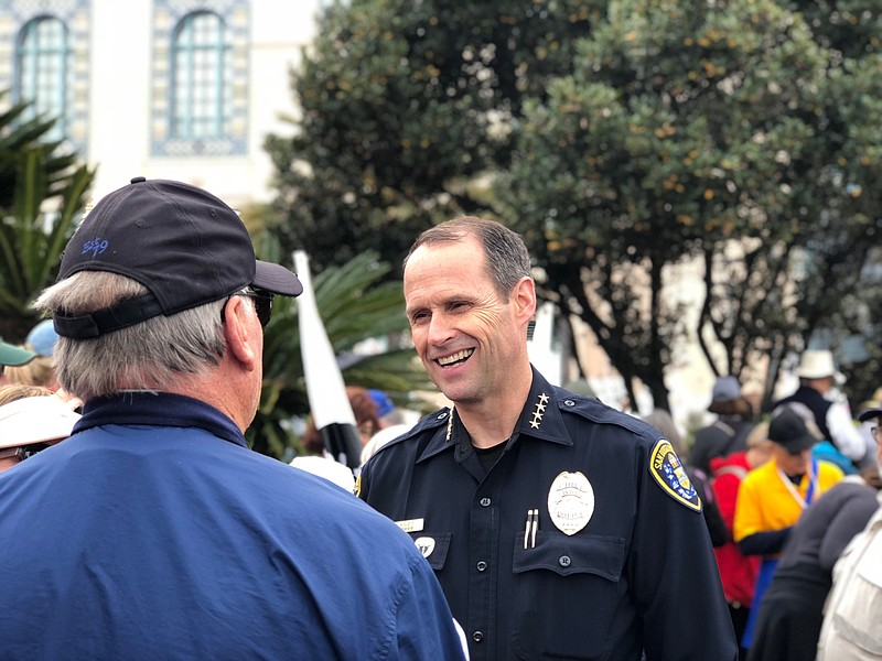 San Diego Police Chief David Nisleit speaks with a demonstrator at the