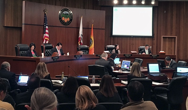 The Orange County board of supervisors gather during a meeting in Santa Ana, ...