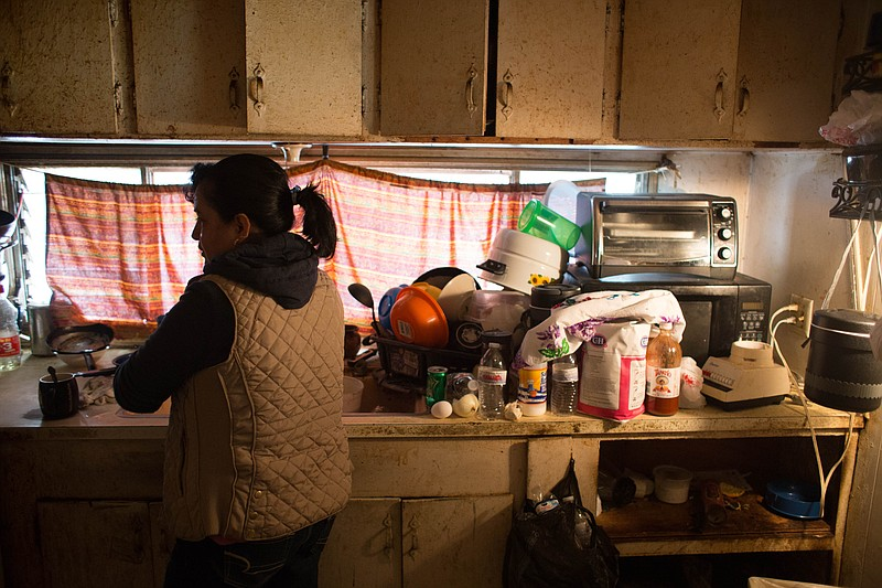 Farmworker Alma in the kitchen on the Fresno mobile home she shares with her ...