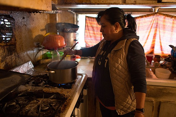 Farmworker Alma in the kitchen on the Fresno mobile home ...