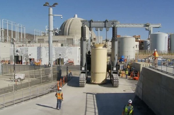 Spent nuclear fuel being moved inside giant canisters fro...