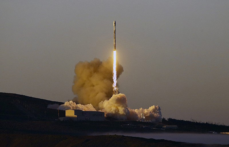 A Falcon 9 rocket lifts off from Vandenberg Air Force Base, Calif., on Friday...