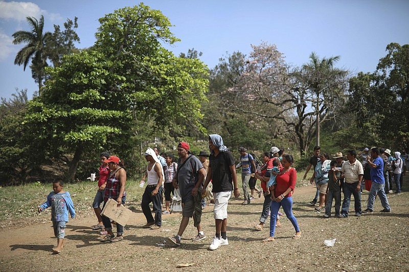 Central American migrants arrive to a sports center during the annual Migrant...