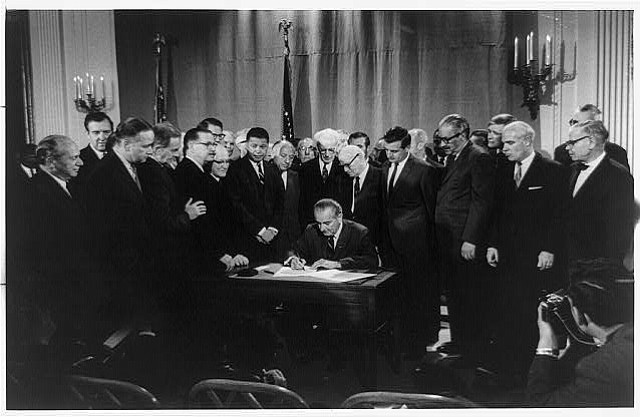 President Lyndon Baines Johnson signs Civil Rights Bill, also known as the Fa...