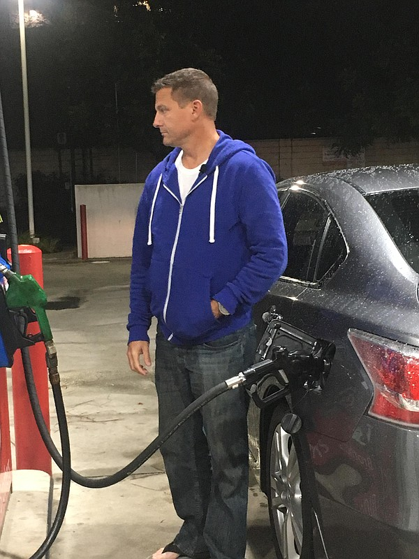 Chad Bordes fills up on gas before starting his first shi...