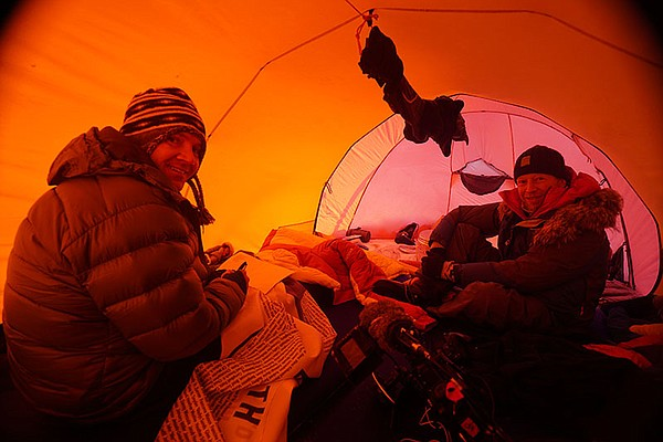 Sean Swarner (left) with another climber in a tent.