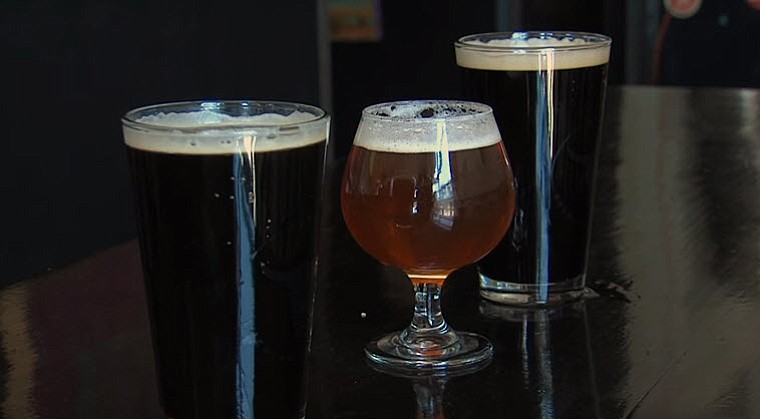 Three glasses of craft beer at the Mike Hess brewery in North Park, San Diego...