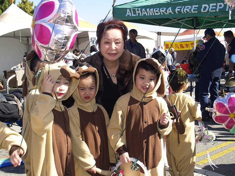 Pinki Chen poses with a group of children dressed up for the year of the dog