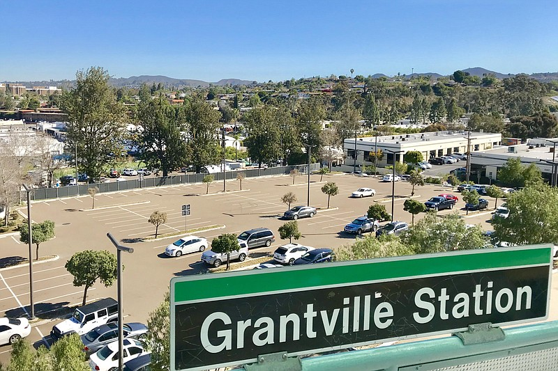 A surface parking lot at the Grantville trolley station sits mostly empty, Ma...