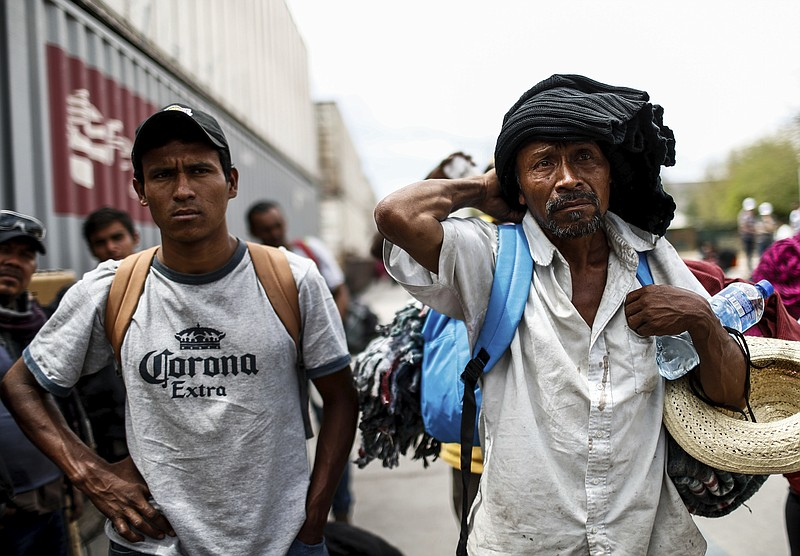 Central American migrants, who attended the annual Migrants Stations of the C...
