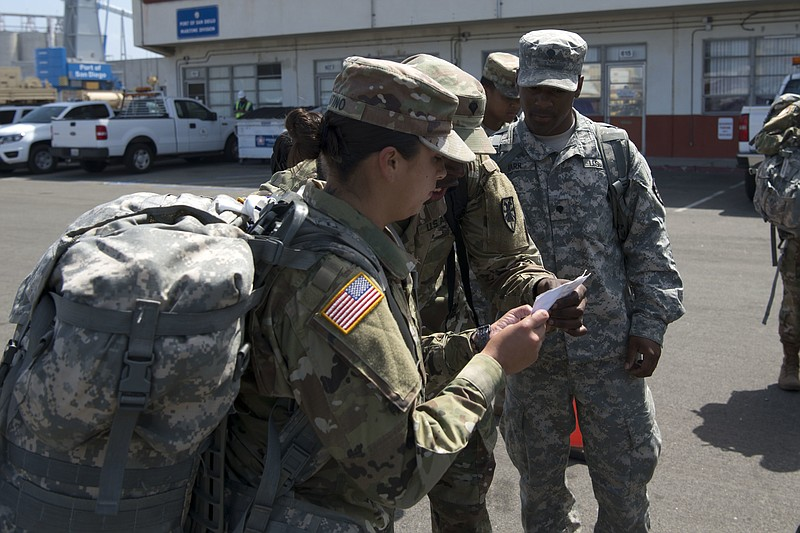 U.S. Army soldiers from various units call out names for accountability at th...