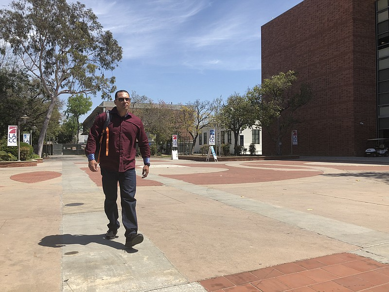John Schimmel walks on campus at Los Angeles City College, April 18, 2018.