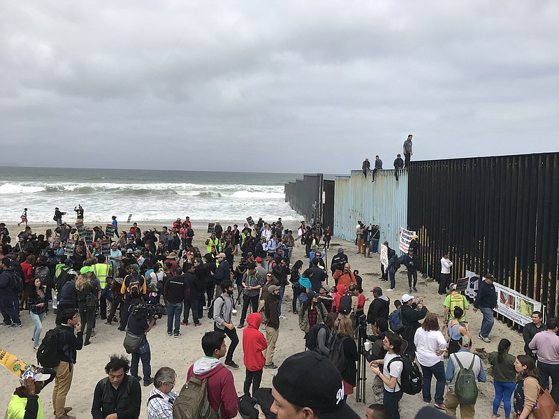 A crowd gathers on the beach in Playas de Tijuana, April 29, 2018.