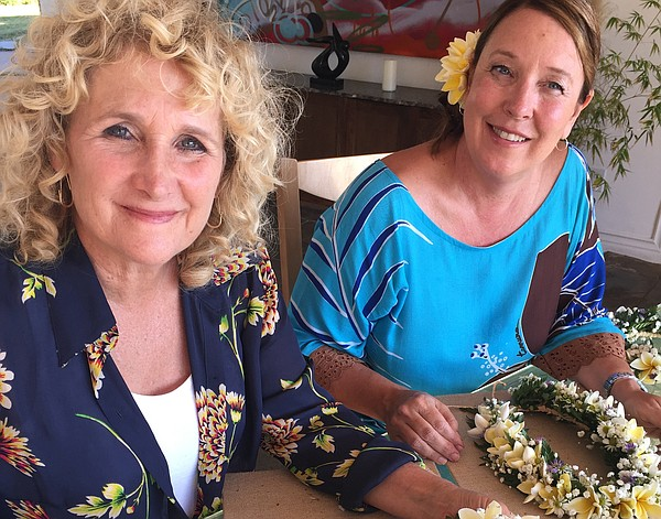 Host Nan Sterman learns how to make a lei with plumeria.