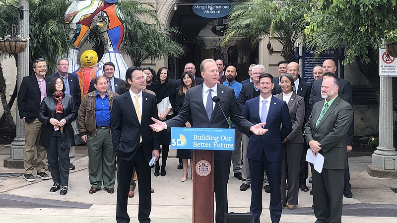 San Diego Mayor Kevin Faulconer speaks at a podium outside of the Mingei Inte...