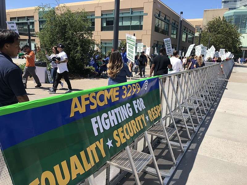 AFSCME 3299 union members rally outside UC San Diego's Jacobs Medical Center,...