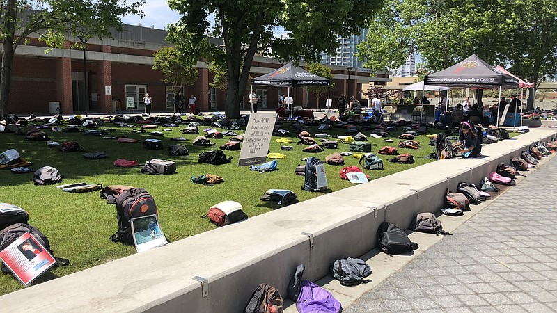 Backpacks spread throughout Curran Plaza at San Diego City College for the
