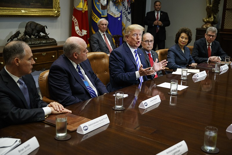 President Donald Trump speaks during a meeting with automotive executives in ...