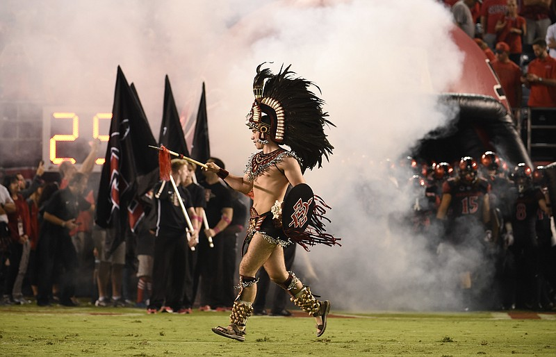 San Diego State mascot the Aztec Warrior comes onto the field before an NCAA ...